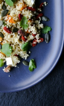 Couscous with dried fruit and nuts, Camembert, cilantro and pumpkin seeds