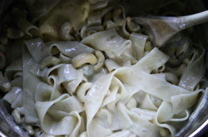 Mixing Pappardelle Pasta, Gorgonzola, Mascarpone and Cashew Nuts