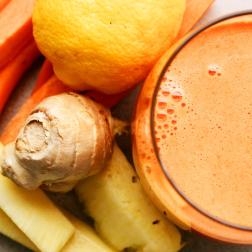 Carrot juice with pineapple, lemon and ginger