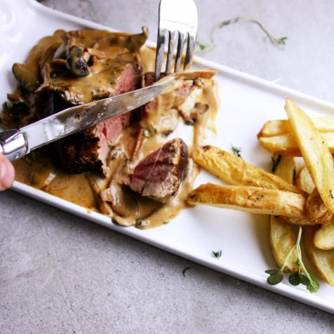 Mushroom sauce with beef fillet and fries