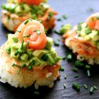 Sushi pizza with sriracha, avocado and salmon