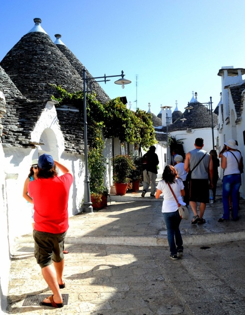 The tourist clad streets of Alberobello