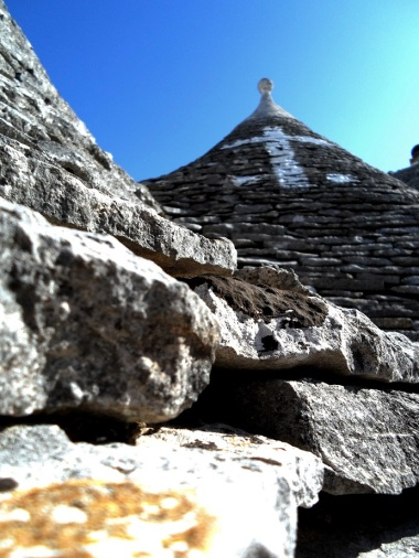 Trulli house roof adorned with a family crest