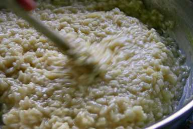 Stirring risotto until the liquid is absorbed