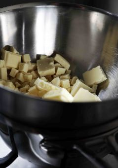 Melt white chocolate over simmering water