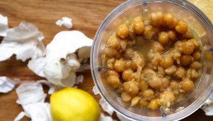 Chickpeas (Garbanzo Beans) boiled with carrot, bay leaves, onion and baking soda, then combined with lemon, garlic and tahini and blended while hot