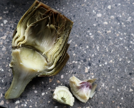 Halved artichoke with choke removed.